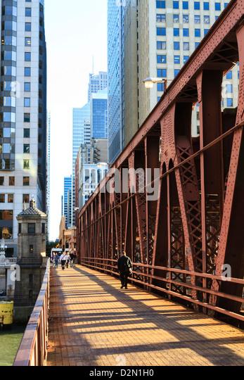 Pedestrians crossing a bridge over the Chicago River, Chicago, Illinois, United States of America, North America - Stock Image
