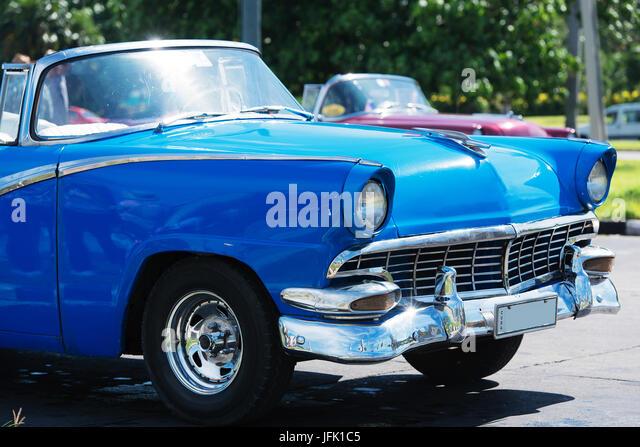 blue American Cabriolet Classic car on street in Havana Cuba - Stock Image