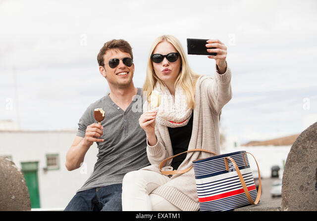 young couple making selfie shoots in the city - Stock-Bilder