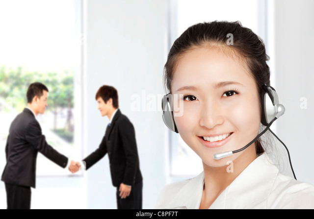 Smiling businesswoman customer service on the phone - Stock Image