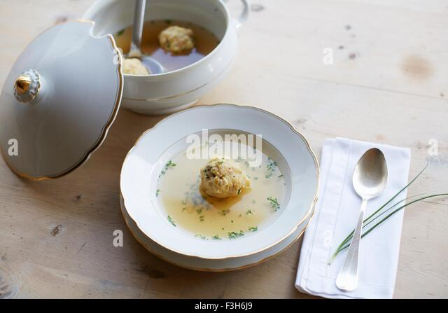 Table with fresh soup and dumpling in a bowl - Stock Image