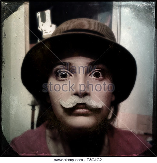 Portrait of a Girl with moustache and hat - Stock Image