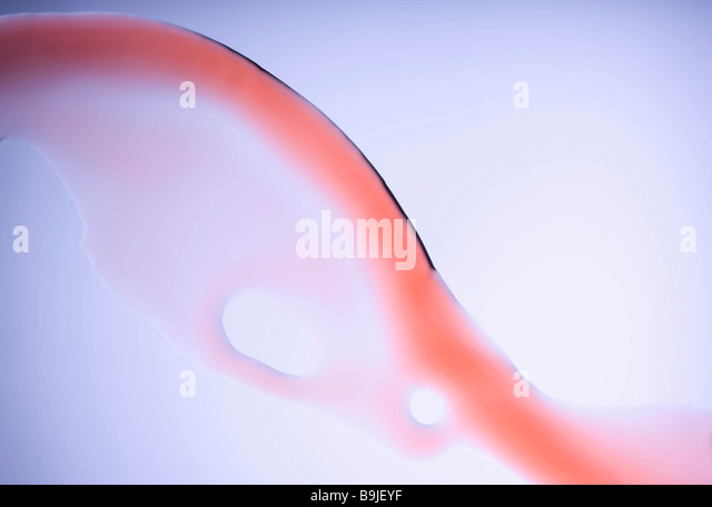 Close up of red water stream - Stock Image