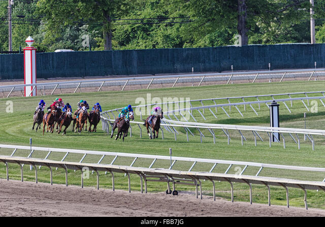 View of a Group of Jockeys on Horses Racing, Monmouth Park Racetrack, Oceanport, New Jersey - Stock Image