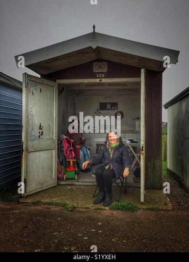 Two women in a beach hut - Stock Image