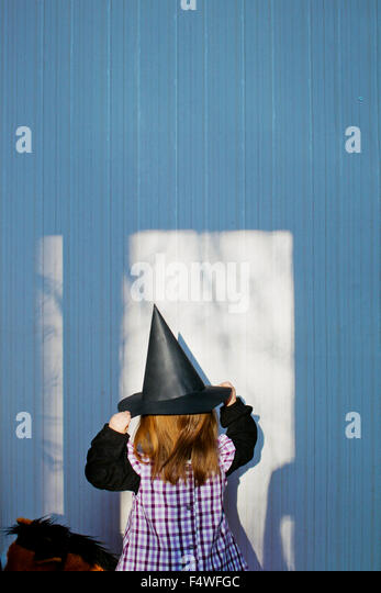 Girl (4-5) wearing costume of witch at Eastertime - Stock Image
