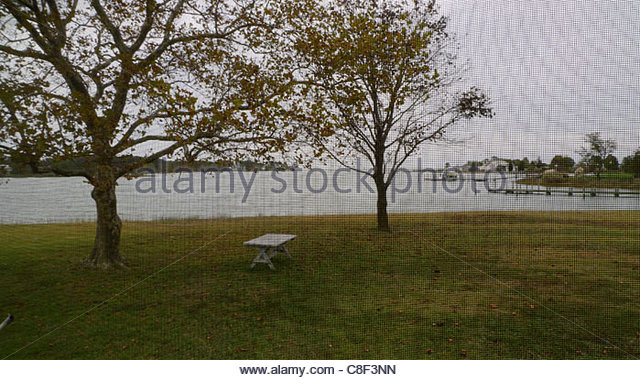 View of the Chesapeake Bay through a screened porch. - Stock Image