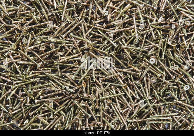 pile of brass screws with screw thread - Stock Image