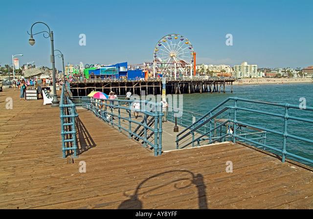 Santa Monica Pier California, CA, USA, US sandy beach, blue water, waves, people  beach hotels, ferris wheel, amusement - Stock Image