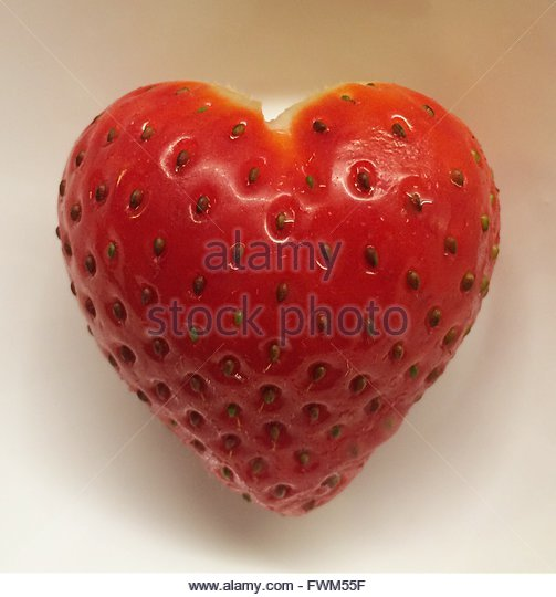 Directly Above View Of Fresh Heart Shape Strawberry On White Background - Stock Image