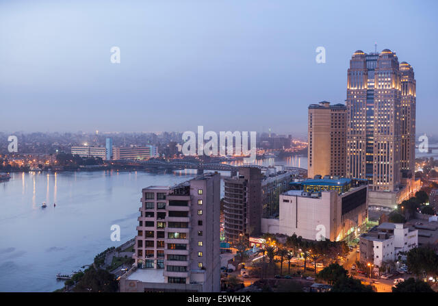 River Nile at dusk in Cairo, Egypt - with the Fairmont Nile City Hotel building on the waterfront - Stock Image