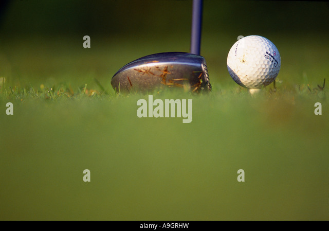 a golf club driver and ball detail of teeing off golf Mortonhempstead Devon England UK - Stock Image