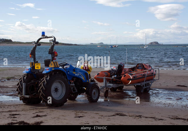 Tractor Pull Boats : Rigid boat uk stock photos images