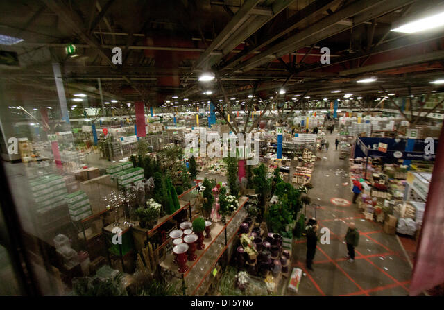 London UK. 10th February 2014. A general view of New Covent Garden Flower Market. Wholesale market vendors sell - Stock Image