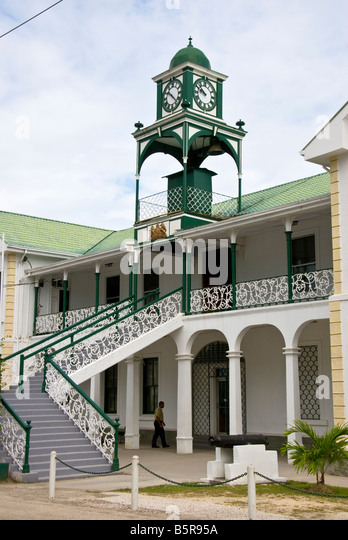 Belize City Supreme Court Building British colonial style architecture historic landmark tourist attraction cannon - Stock Image