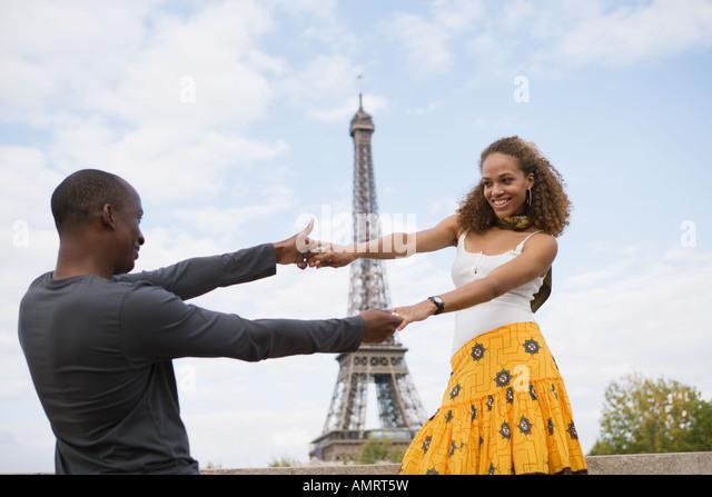 African couple dancing outdoors - Stock-Bilder