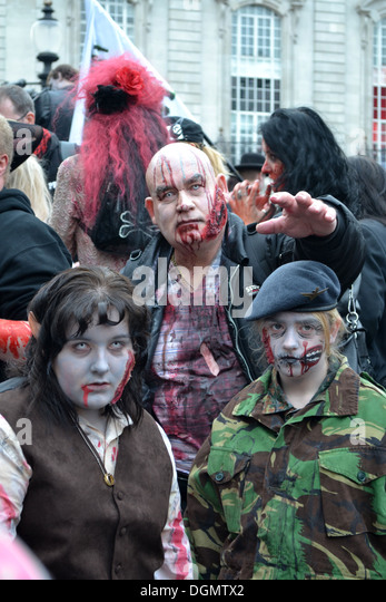 People dressed as zombies, Piccadilly Circus, London, England. For World Zombie Day charity event. Hobbit zombie, - Stock Image