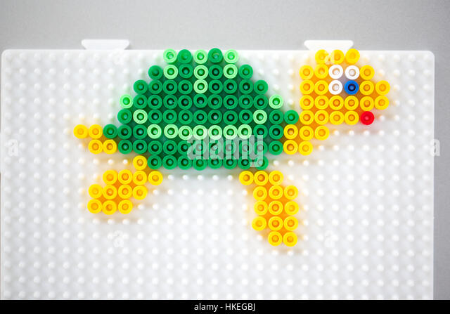 turtle made of fusible beads on pegboard. beads craft, design, toy animal, plastic. - Stock-Bilder