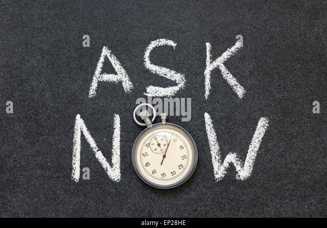 ask now phrase handwritten on chalkboard with vintage precise stopwatch used instead of O - Stock Image