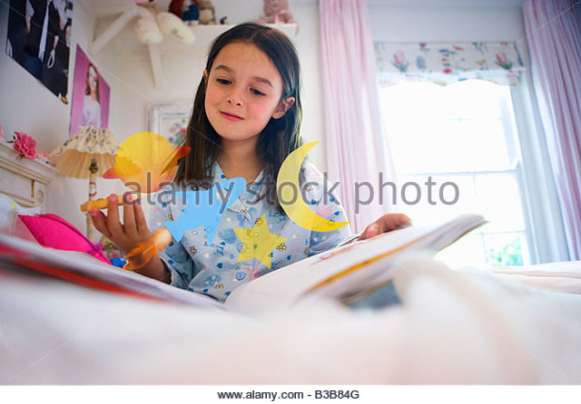 Girl daydreaming about space exploration - Stock Image
