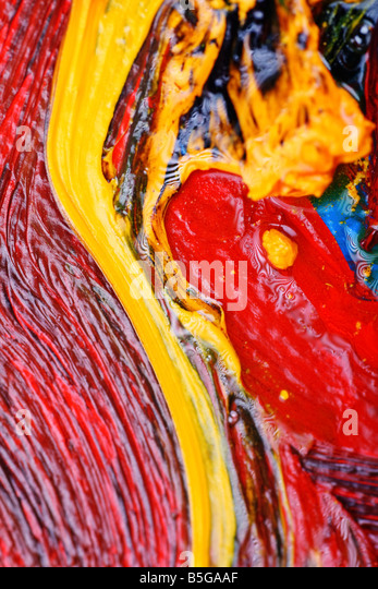 artists abstract oil painting showing vibrant colors texture and flow - Stock Image