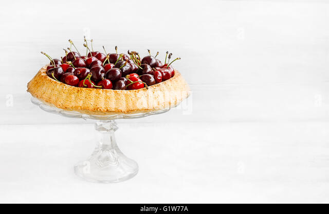 Sweet cherries tart, tasty pie with fresh fruits - Stock Image