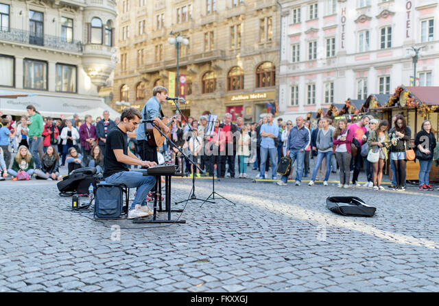 Street band playing for tourists in the streets of Prague - Stock Image