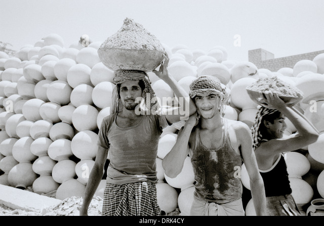 Workers in Jaisalmer in Rajasthan in India in South Asia. Work Labor Labour Manual Tough Hard Reportage Man Men - Stock Image