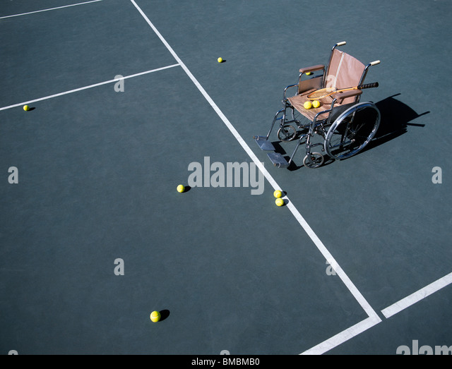 Still-life of an Empty Wheelchair on Tennis Court - Stock Image