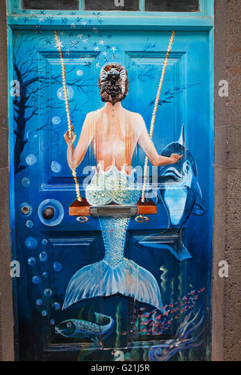 Swings Mermaid, street art, artistically painted door, historical centre of Funchal, Madeira, Portugal - Stock-Bilder
