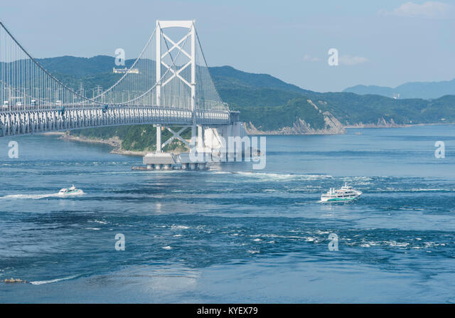 the background of the famous japan kaikyo bridge In this course you will get to feel seasons in japan awaji island is famous  akashi kaikyo bridge  there are akashi channel and gulf of osaka in the background.