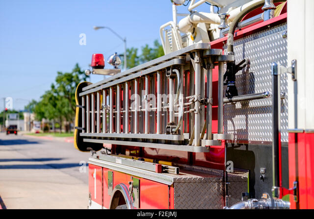 A fire engine showing the side down from the front, in Bethany, Oklahoma. - Stock Image