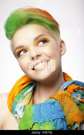 Funny Smiling Woman with Colored Hairs Looking Up - Stock Image