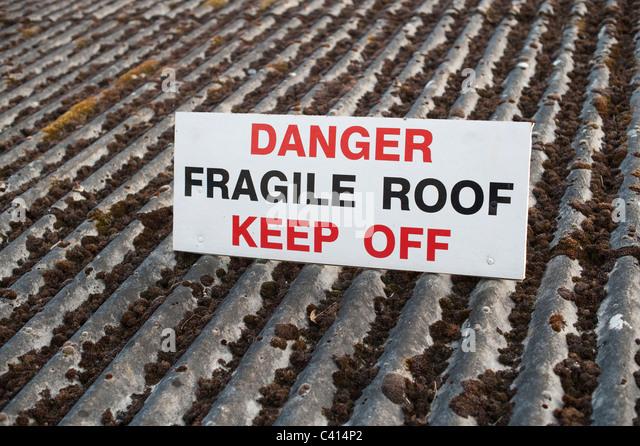Danger fragile roof keep off sign uk - Stock Image