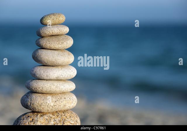 Stone balance pebble stones on beach - Stock-Bilder