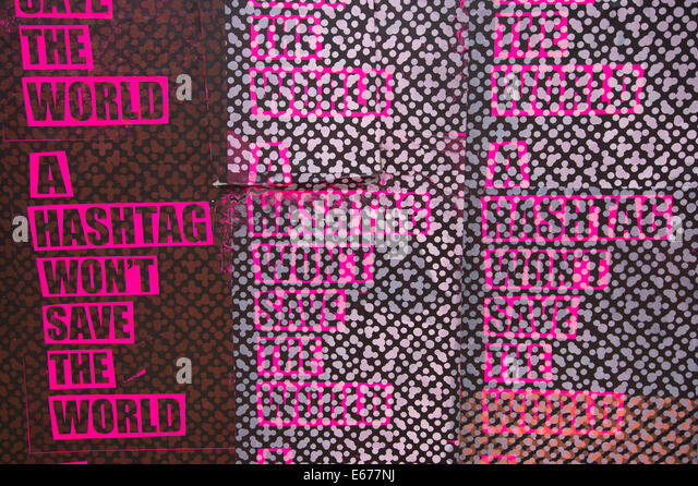 London. Hackney Wick.Street art poster with graphic design of words saying 'A hashtag won't save the world'. - Stock Image