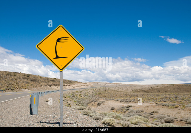traffic road sign on the Ruta Nacional 40, heavy side wind, Santa Cruz, Patagonia, Argentina - Stock Image