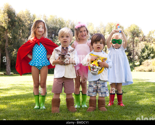 Group of kids playing dress up - Stock Image