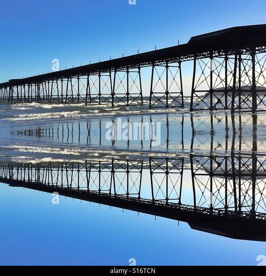 Victorian pier reflection - Stock-Bilder