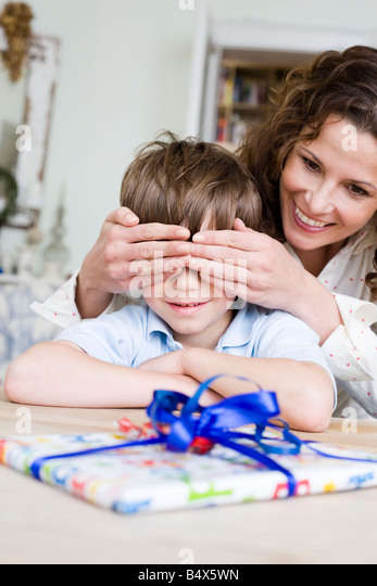 Mom is surprising her son - Stock Image