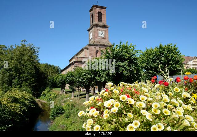 France, Territoire de Belfort, Lachapelle sous Rougemont, church, La Bourbeuse river, flowers - Stock Image