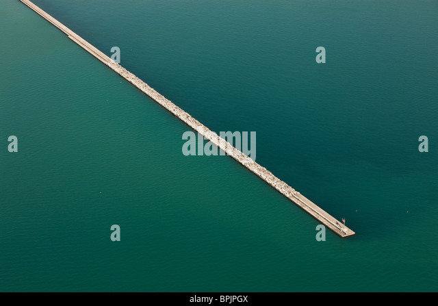 Abstract aerial photograph of breakwater jetty in water on Lake Michigan in Chicago. - Stock Image