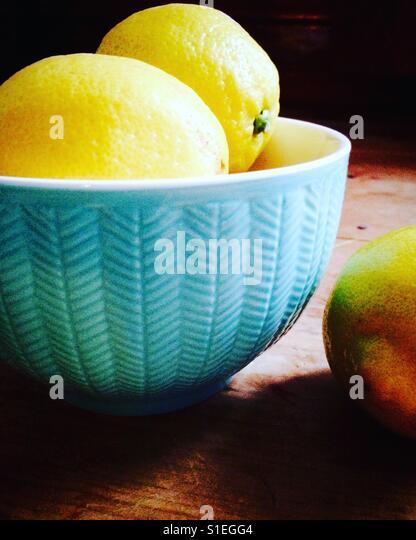 A bowl of lemons - Stock Image