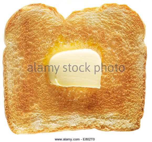 traditional white toast slice bread with butter on white background - Stock Image