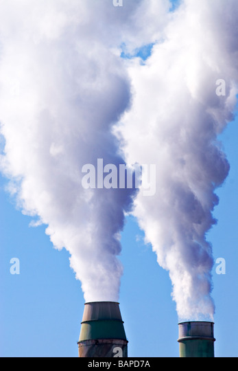 Industrial Pollution / Two smokestacks spew smoke into the air.Geelong Victoria Australia. - Stock Image