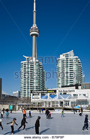 Skating rink at Harbourfront Centre with CN Tower behind in Toronto Ontario Canada - Stock Image