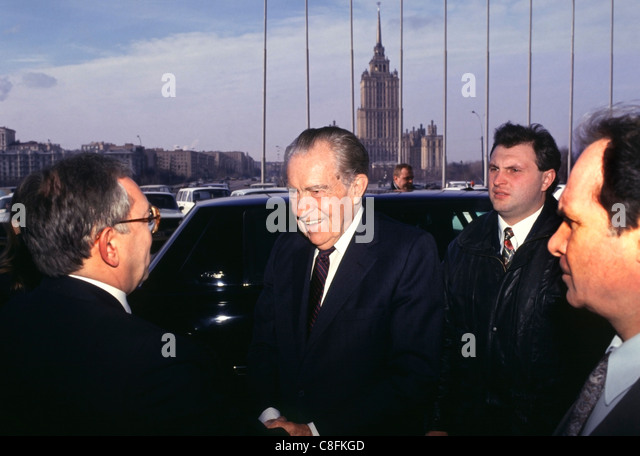 Former U.S. President Richard Nixon (Center) being greeted at the entrance to the Russian Duma in Moscow in 1994. - Stock Image