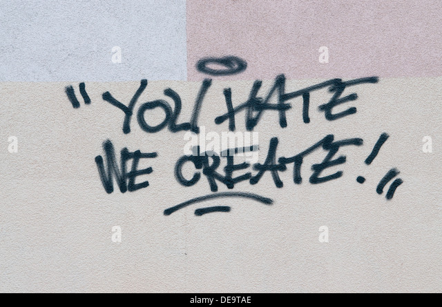 'You Hate we create' graffiti on the wall of apartments building in Poland. - Stock Image