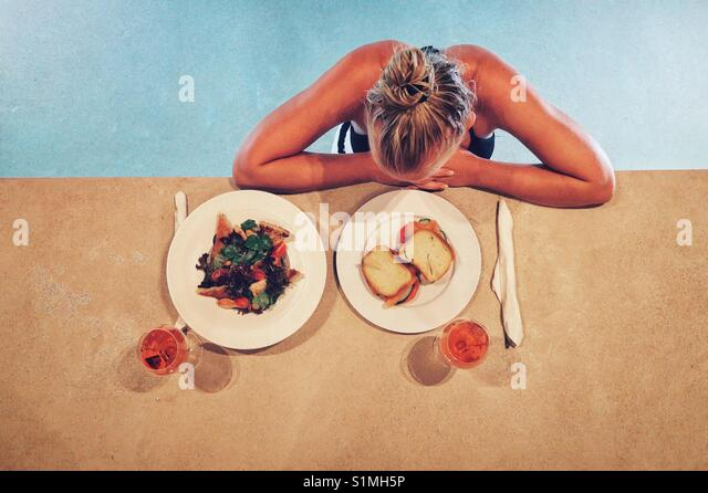 Woman dining in spa - Stock Image