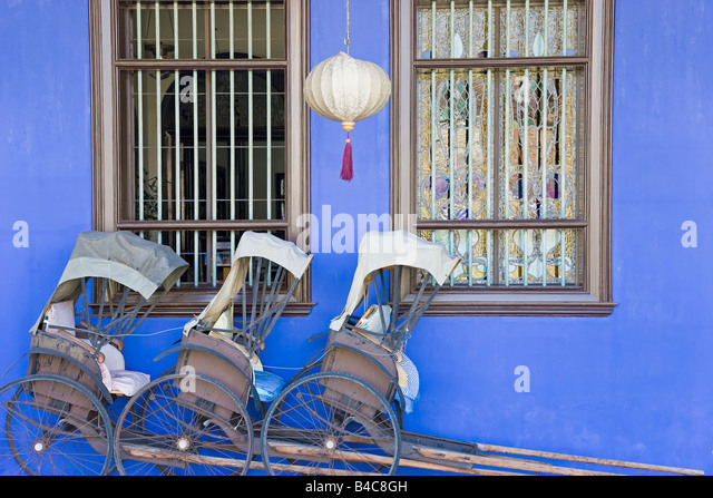 Asia, Malaysia, Penang, Pulau Pinang, Georgetown, Chinatown district, detail of Trishaws lined up against a blue - Stock Image